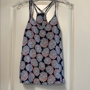 Navy tank with blue, red, and white floral design